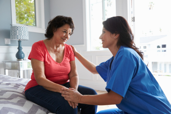 caregiver and a woman staring to each other
